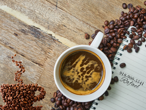 Overhead photo of coffee cup and coffee beans